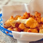 Beer Battered Cheese Curds are the only appetizer you'll ever need. Stringy, melted cheese in a crispy beer batter.