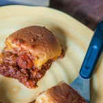 Chili Cheese Dog Sliders are the perfect way to celebrate National Hot Dog Day. Homemade hot dog chili and hot dogs on slider buns.