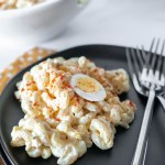 Deviled Egg Macaroni Salad is our favorite way to use up hard boiled eggs. It's packed with eggs and a delicious creamy sauce.