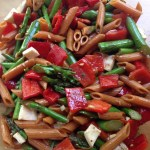 Summer pasta salad with asparagus, roasted peppers, and fresh mozzarella