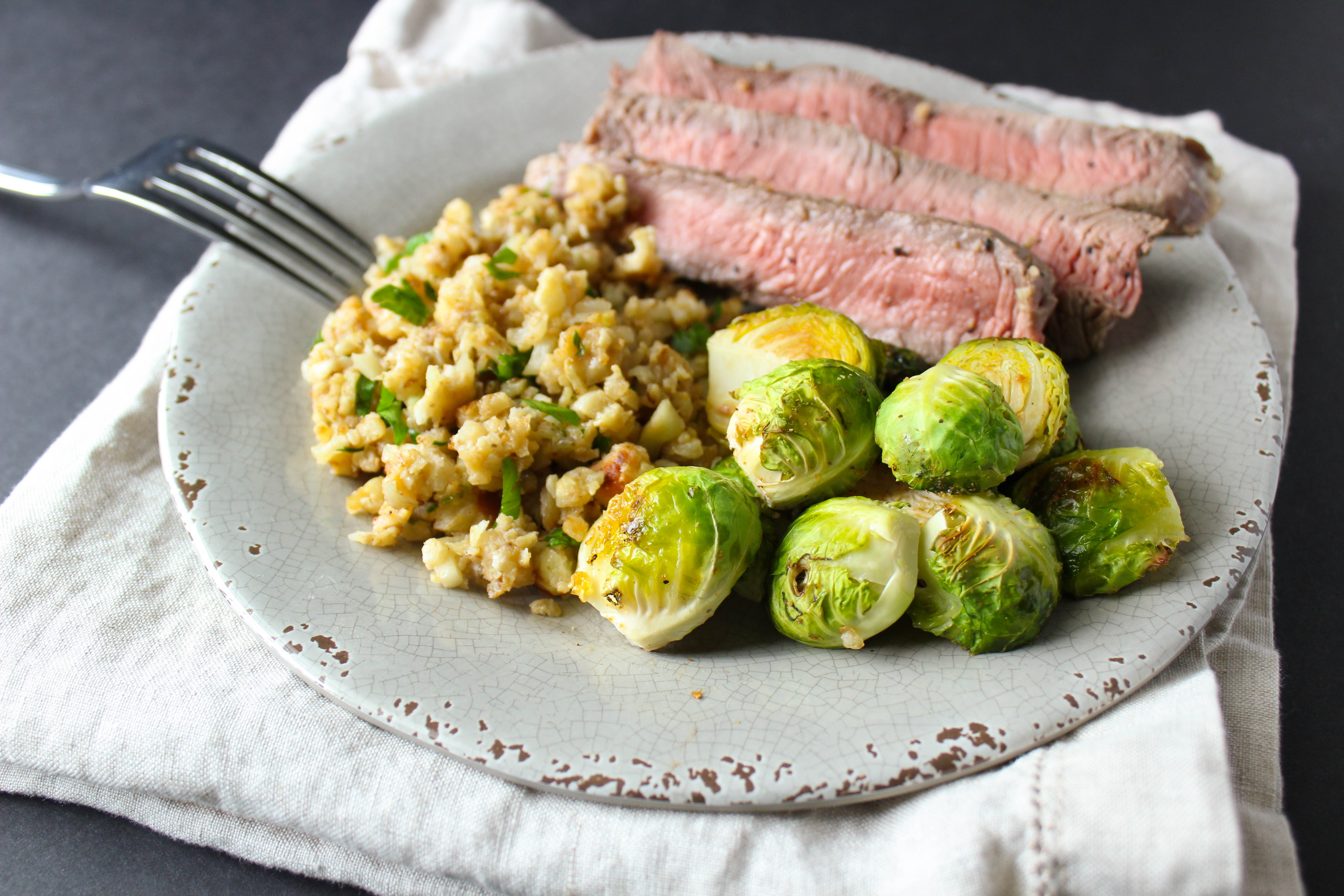 steak with riced cauliflower and brussel sprouts
