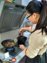 A student showing me how to cook Sichuan food.