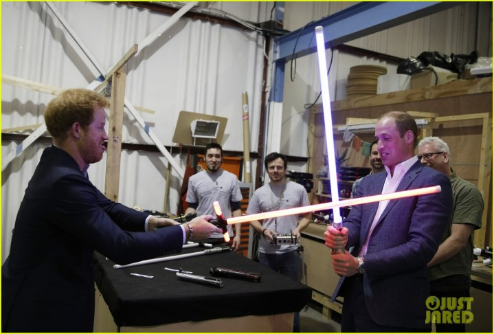 IVER HEATH, ENGLAND - APRIL 19: Prince Harry (L) and Prince William, Duke of Cambridge try out light sabres during a tour of the Star Wars sets at Pinewood studios on April 19, 2016 in Iver Heath, England. Prince William and Prince Harry are touring Pinewood studios to visit the production workshops and meet the creative teams working behind the scenes on the Star Wars films. (Photo by Adrian Dennis-WPA Pool/Getty IMages)