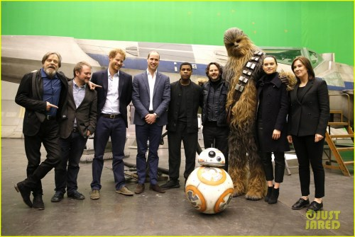 IVER HEATH, ENGLAND - APRIL 19: (L-R) US actor Mark Hamill, US director Rian Johnson, Britain's Prince Harry, Britain's Prince William, Duke of Cambridge and British actor John Boyega, (C) pose with Chewbacca and British actress Daisy Ridley (2nd R) during a tour of the Star Wars sets at Pinewood studios on April 19, 2016 in Iver Heath, England. Prince William and Prince Harry are touring Pinewood studios to visit the production workshops and meet the creative teams working behind the scenes on the Star Wars films. (Photo by Adrian Dennis-WPA Pool/Getty IMages)