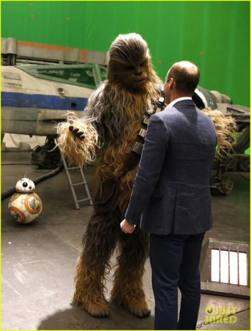 IVER HEATH, ENGLAND - APRIL 19: Prince William, Duke of Cambridge talks with Chewbacca during a tour of the Star Wars sets at Pinewood studios on April 19, 2016 in Iver Heath, England. Prince William and Prince Harry are touring Pinewood studios to visit the production workshops and meet the creative teams working behind the scenes on the Star Wars films. (Photo by Adrian Dennis-WPA Pool/Getty IMages)