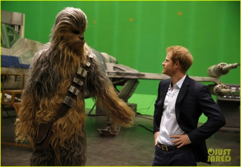 IVER HEATH, ENGLAND - APRIL 19: Prince Harry (R) meets Chewbacca during a tour of the Star Wars sets at Pinewood studios on April 19, 2016 in Iver Heath, England. Prince William and Prince Harry are touring Pinewood studios to visit the production workshops and meet the creative teams working behind the scenes on the Star Wars films. (Photo by Adrian Dennis-WPA Pool/Getty IMages)
