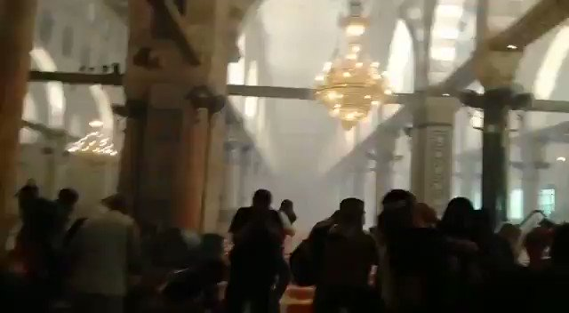 NEW - The moment Israeli forces entered the mosque. Shouting and loud bangs can be heard as tear gas pours into the building.