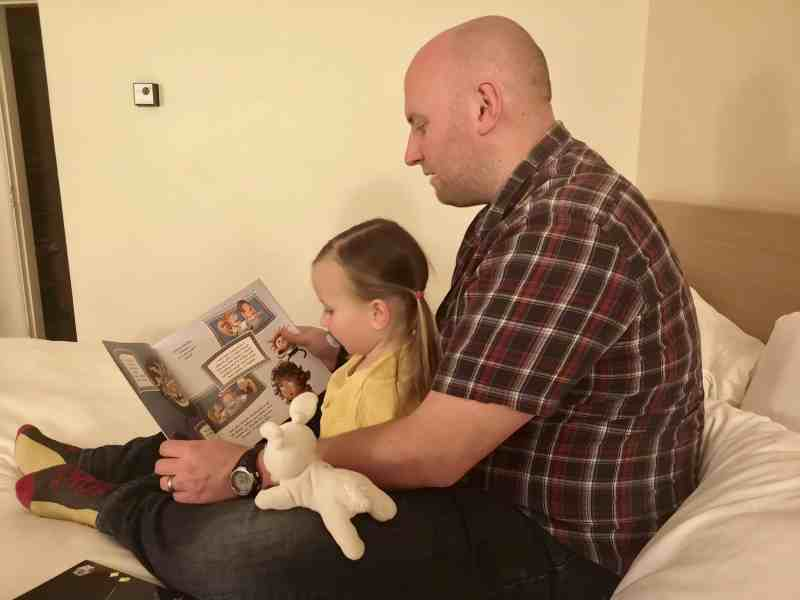 John and Erin reading in a hotel