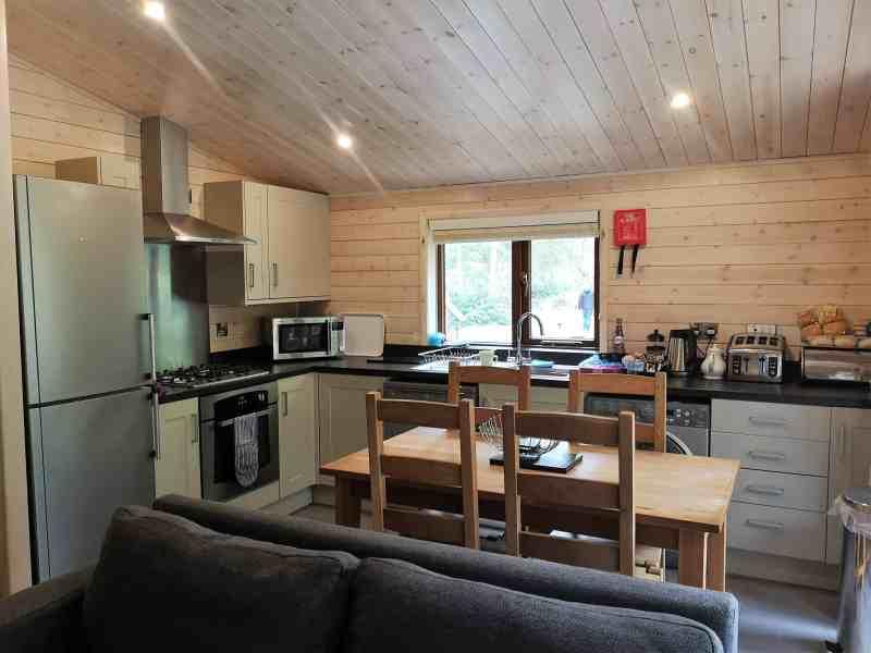 Kelling Heath 2 bedroom woodland lodge dining area