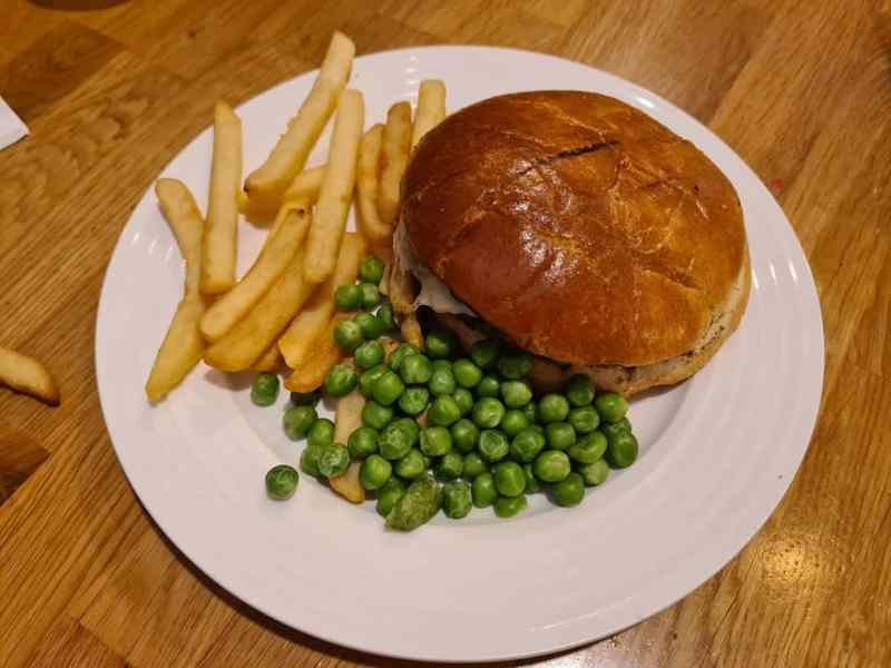 Child's burger, chips and peas