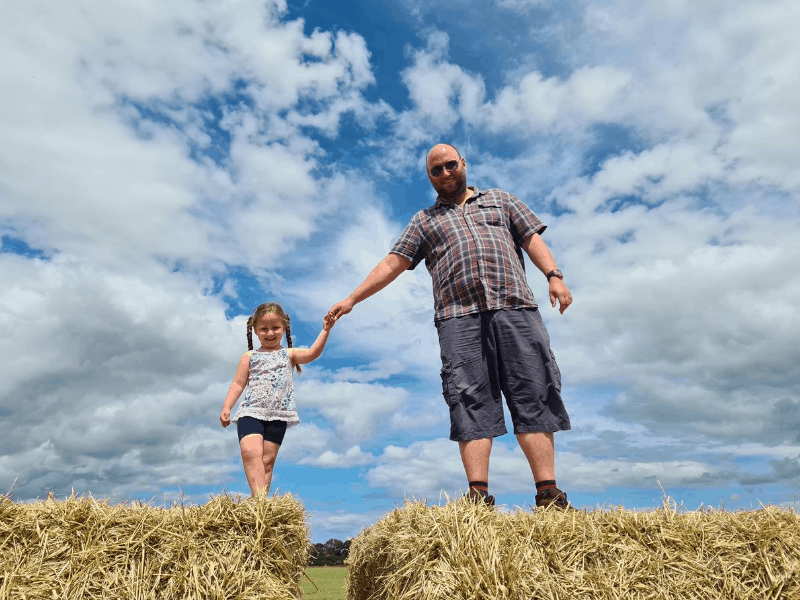 John and Erin on straw bales