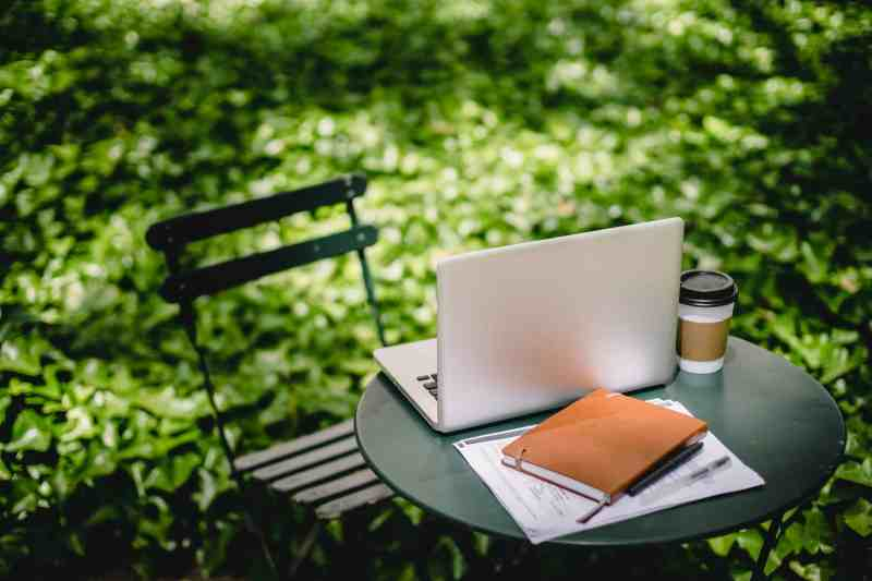Garden table with laptop
