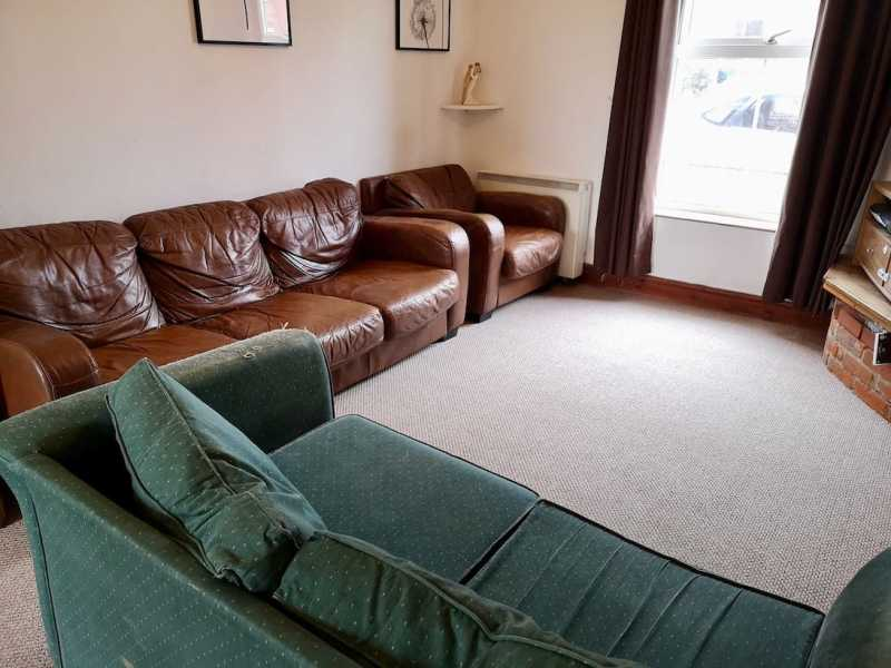 Living room before with storage heater