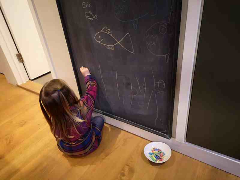 Erin colouring on the chalk board