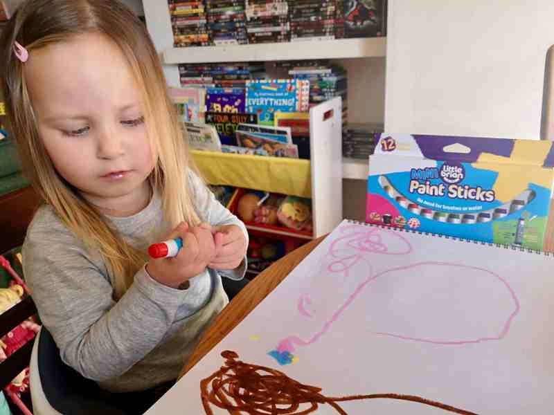 Erin playing with Little Brian Paint Sticks