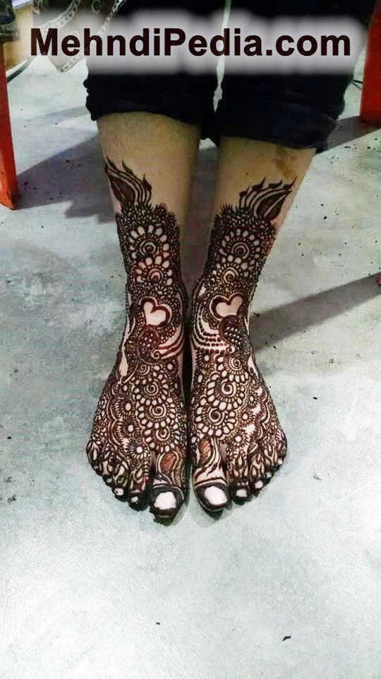 henna inspired foot tattoos