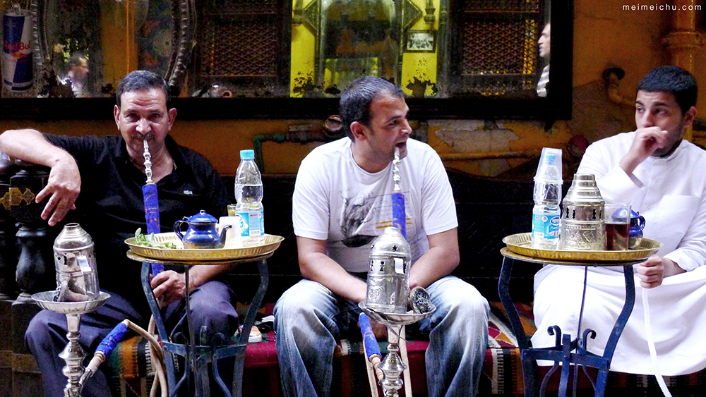 Three men enjoying shisha at Khan el Khalili.