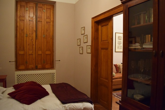 My room complete with old fashioned wooden shutters that opened into the courtyard.