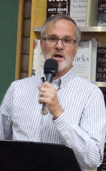 David Meischen at the microphone, co-hosting the Albuquerque release of Weaving the Terrain: 100-Word Southwestern Poems