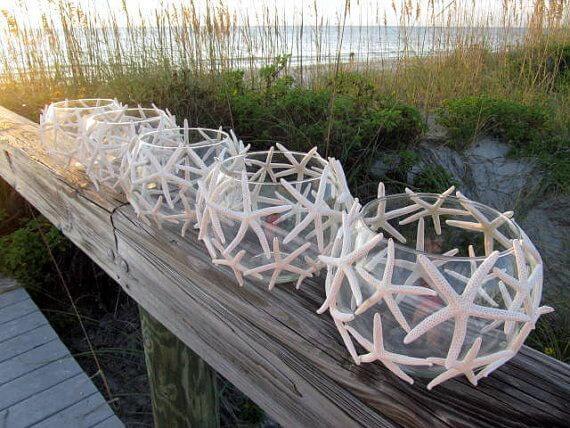 Faroles con peceras y estrellas de mar