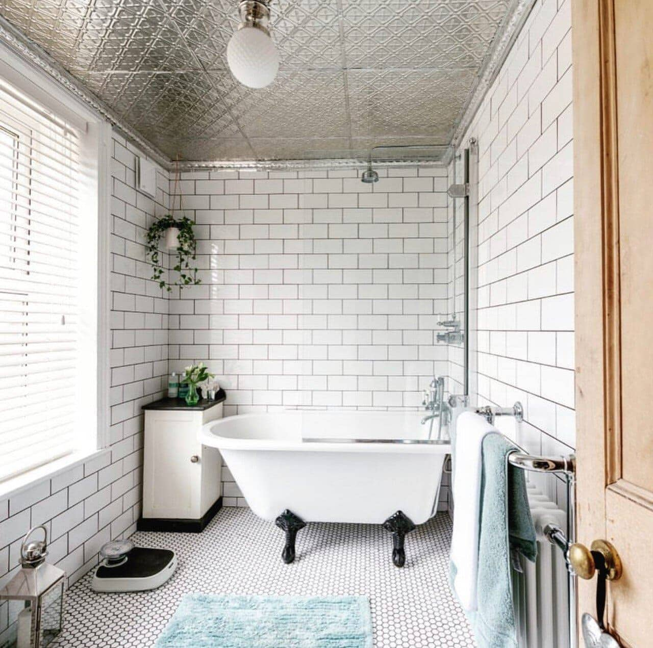 Danielle has created a wonderful space in this bathroom, that was quite a small and dark room by adding tin tiles. Image:  @addictedtohouse  Photo Credit: Jeremy Philips