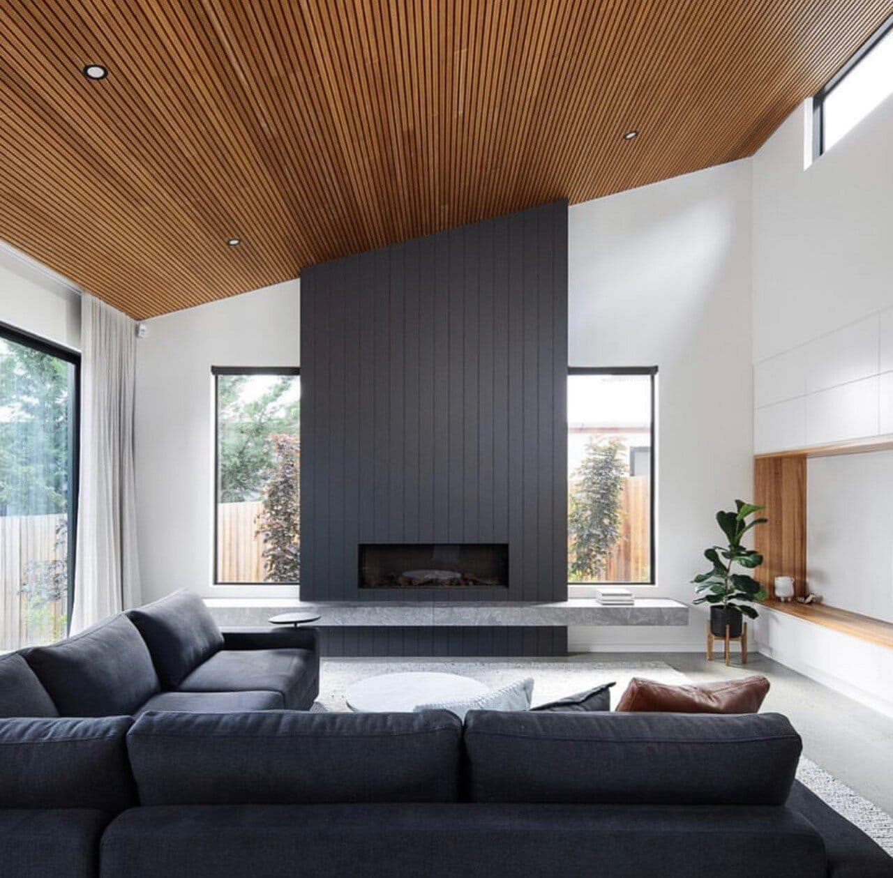 This room is blessed with high ceilings so is perfect for timber providing a wonderful contrast to the grey and granite. Credit:  @paul_tilse_architects  Photo Credit:  @rodrigo.vargas.photography