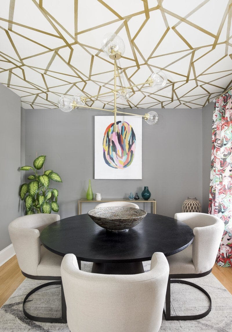 The geometric gold tape perfectly compliments the statement lighting