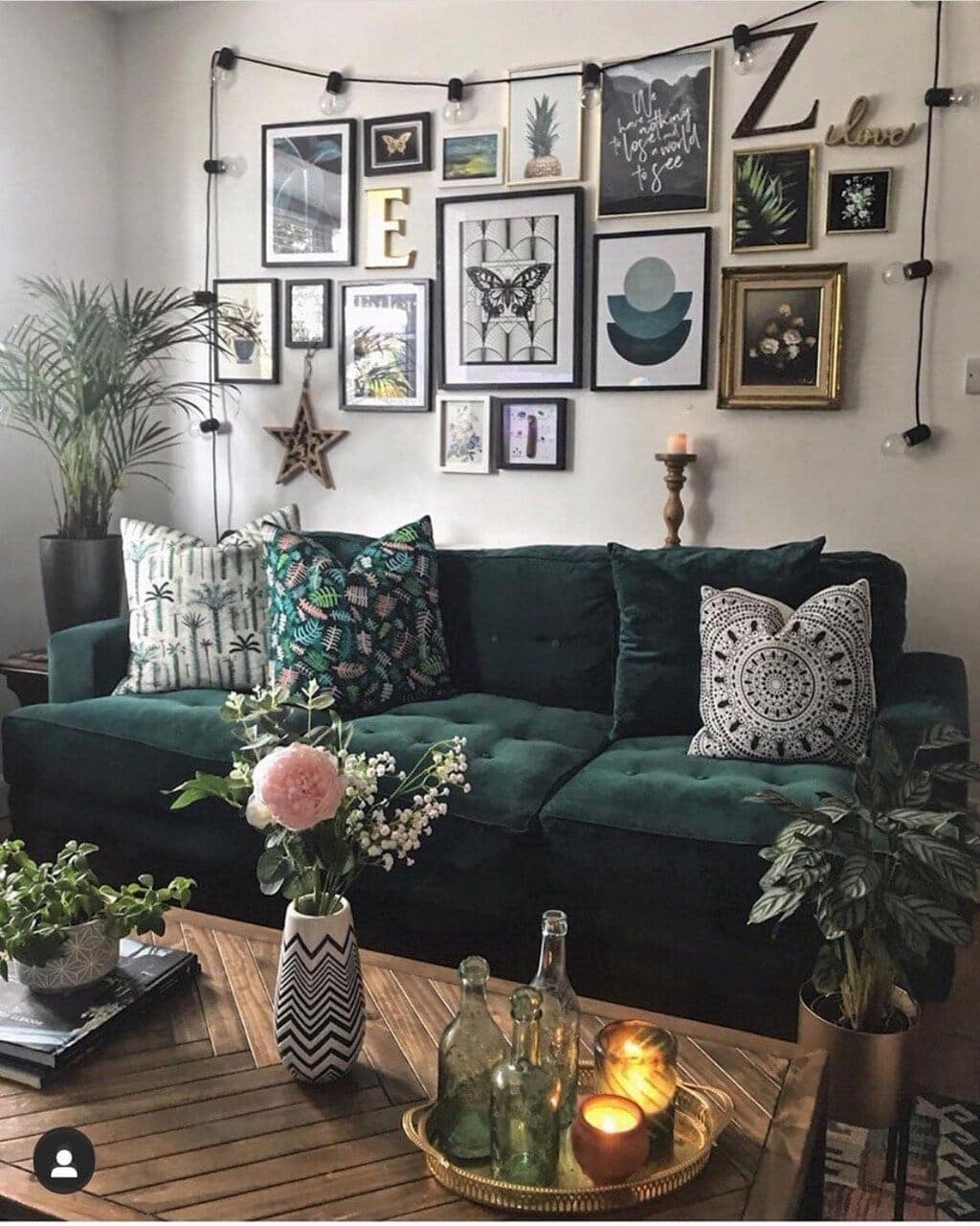 This is the gallery wall that now sits opposite my green feature wall. I kept to the green and natural elements of the room with my prints