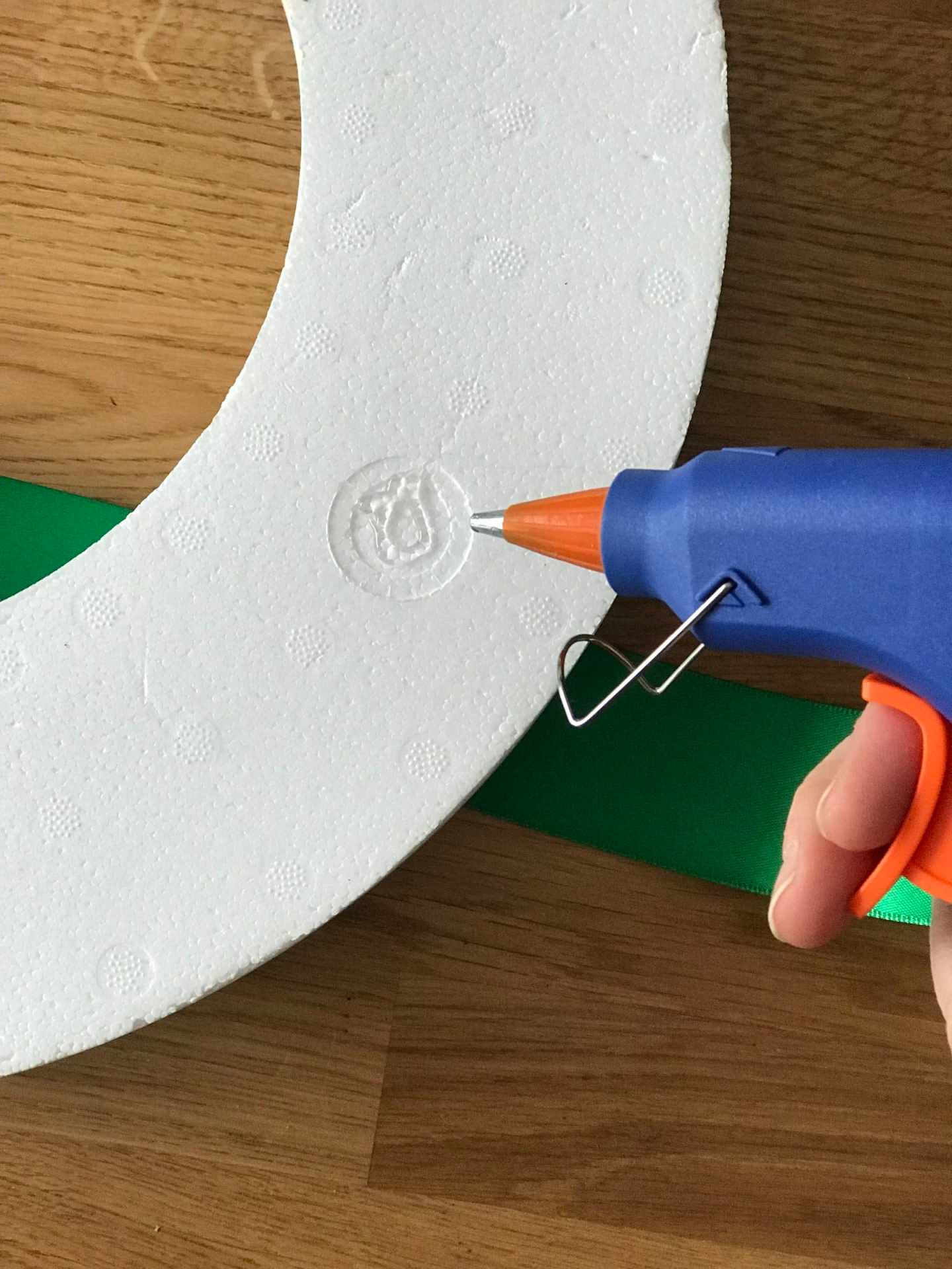 Applying a small amount of glue to fix the ribbon