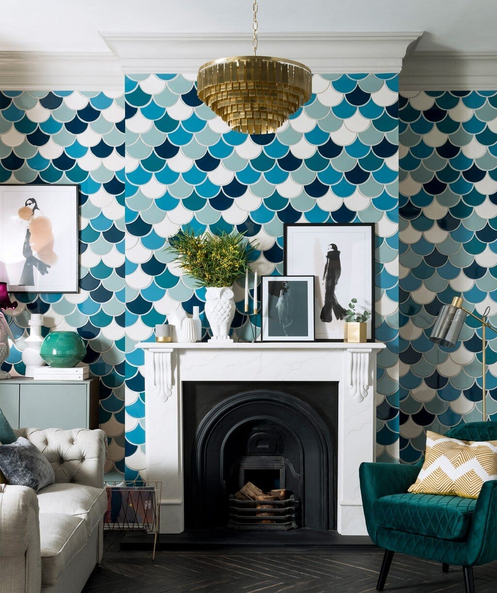 Using the Syren tiles around the fireplace in the living room, unusual but it kind of works! Credit: Topps Tiles