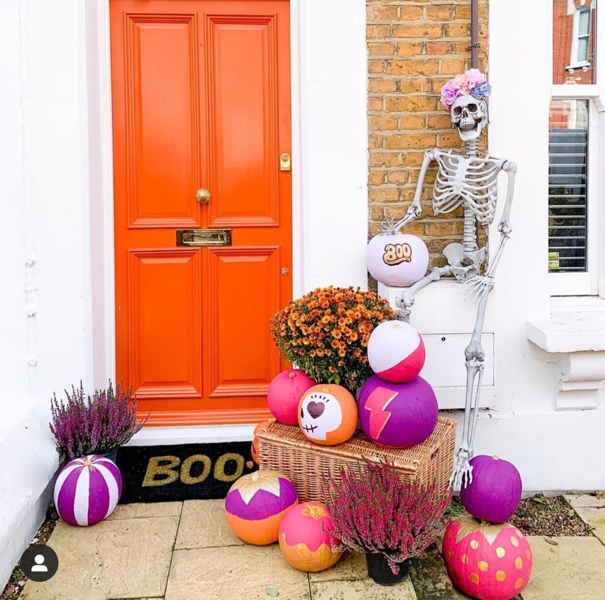 Bright purples, oranges and pinks for Jess, all overlooked by a skeleton. You couldn't get a more perfect door colour for Halloween! Instagram -    @gold_is_a_neutral