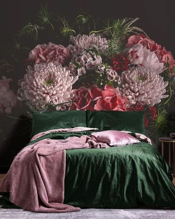 A very extravagant floral mural which is perfectly complimented with emerald bedding and a pink throw Credit: @muralswallpaper