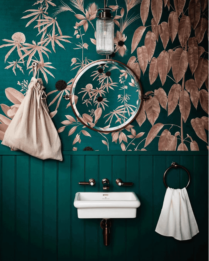 Green panelling with green and copper pink wallpaper Credit: @drummonds_bathroom