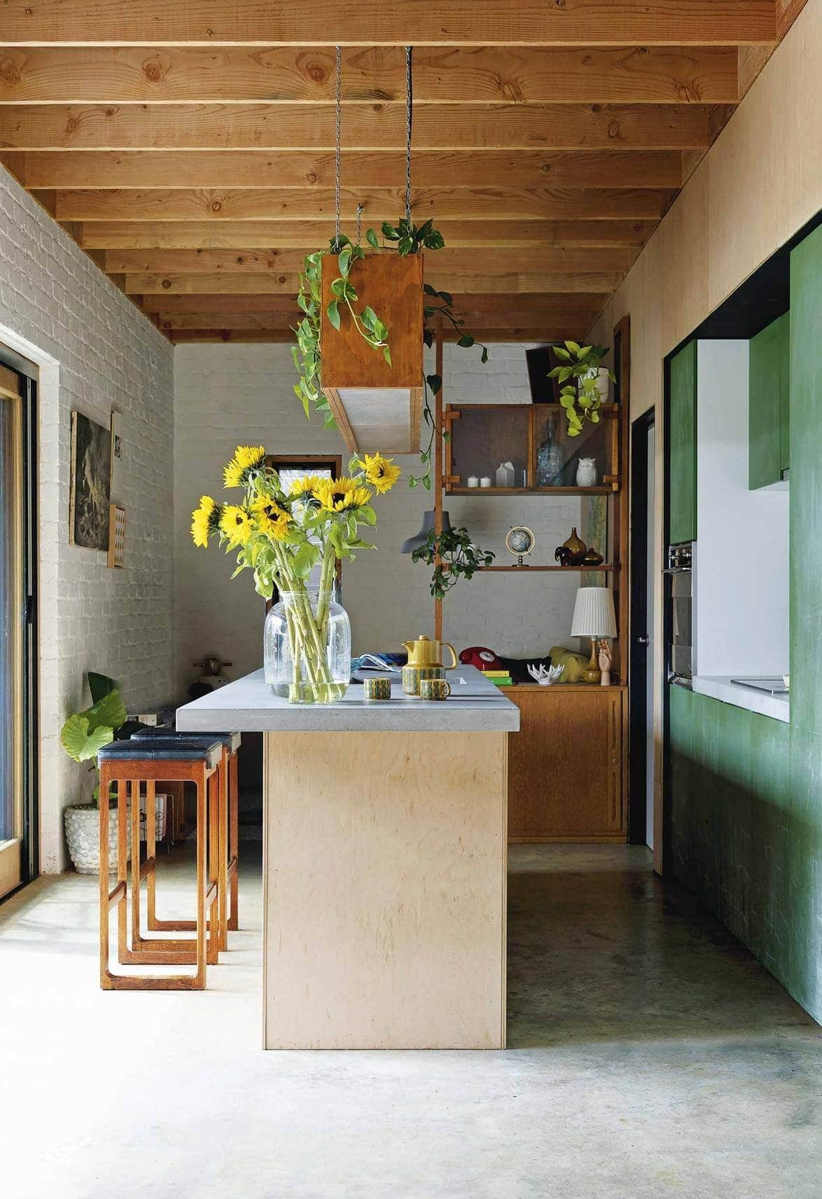 By leaving the ceiling exposed, it adds height and warmth to this kitchen. Credit:  www.homestolove.com.au