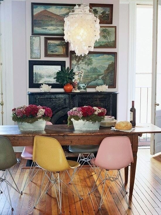 Beautiful vintage artwork which is displayed in a rectangular shape on the chimney breast Image: Apartment Therapy