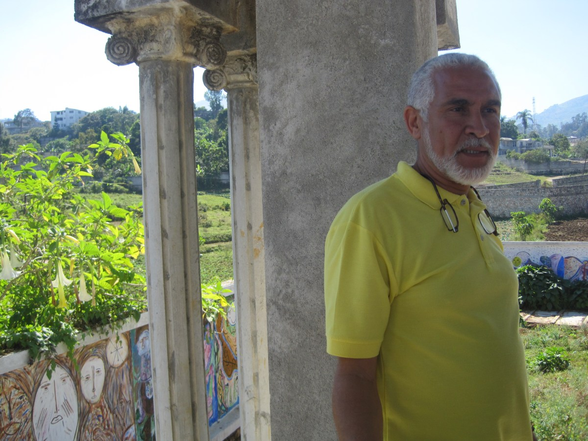 Philippe at the Saint Soleil Cemetery--see bit of mural in background