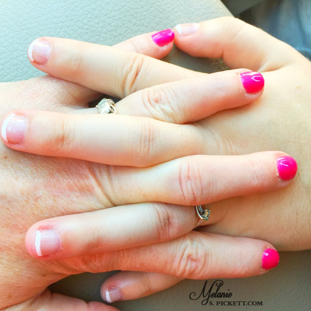 When your child leaves for college. Mom and daughter clasped hands.