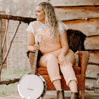 Pink dungarees with banjo and western booties