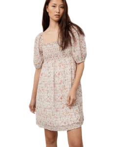 The dress is a prairie style with smocked bodice, elastic square neckline, puff sleeves, and elastic cuffs at the elbow. Feminine and flattering, this dress is the perfect throw-on-and-go style for any occasion.