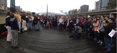 The crowd gathered to listen to the Enterprize singers