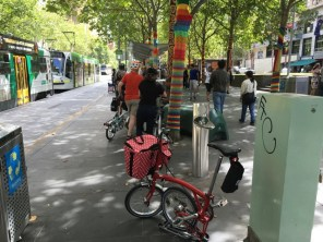 Another form of art - yarn bombing trees along Swanston Street