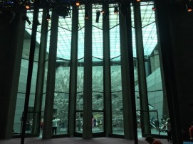 """Through the glass doors of the Great Hall to """"Forever Bicycles"""" in the atrium"""