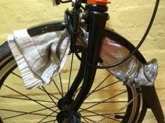 Carefully clean under the mudguard - it's only plastic so be careful not to let it bunch up too much. Enough to clean, not enough to break
