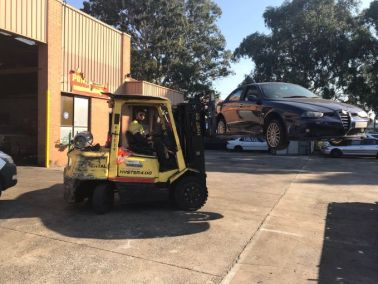 Car removal workers at work