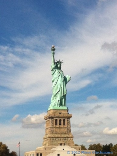 "The ferry to Ellis Island first stops at Llberty Island. Here you will see the Statue of Liberty, constructed in Paris, France in the 1880s and proclaimed as the ""Eighth marvel of the world."" From ground to the top of the torch, she is 305 feet, 1 inch tall. And she is OH so glorious!"