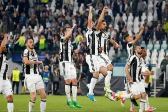 Juventus players celebrate their 3-0 win, at the end of a Champions League, quarterfinal, first-leg soccer match between Juventus and Barcelona, at the Juventus Stadium in Turin, Italy, Tuesday, April 11, 2017. (AP Photo/Antonio Calanni)