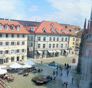 City square. Under the glass pyramid you can get a glimpse of the old city wall