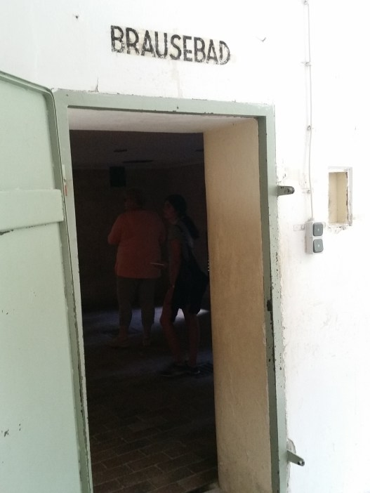They told prisoners they were beingn taken to the shower, the room is labled as such