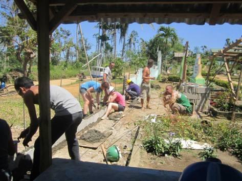 Rebuilding a wall after Yolanda.