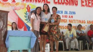 With Principal Frecie de Angel (left) of Tanza Elementary School.